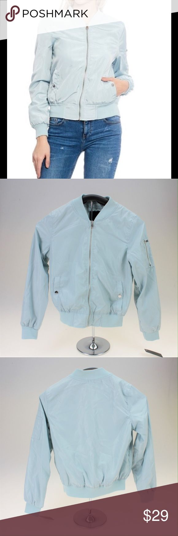 """Baby Blue Lightweight Bomber Jacket This adorable jacket is the trendy piece your wardrobe needs. It's lightweight material makes it comfortable to wear in spring and summer weather. This is a boutique piece, but has a manufacturer defect along the zipper lining as shown in the photos. There is also a small mark on the collar that occurred during storage. Willing to accept a reasonable offer with these things considered. The jacket measures approximately 36"""" around the bust and is about 22""""…"""