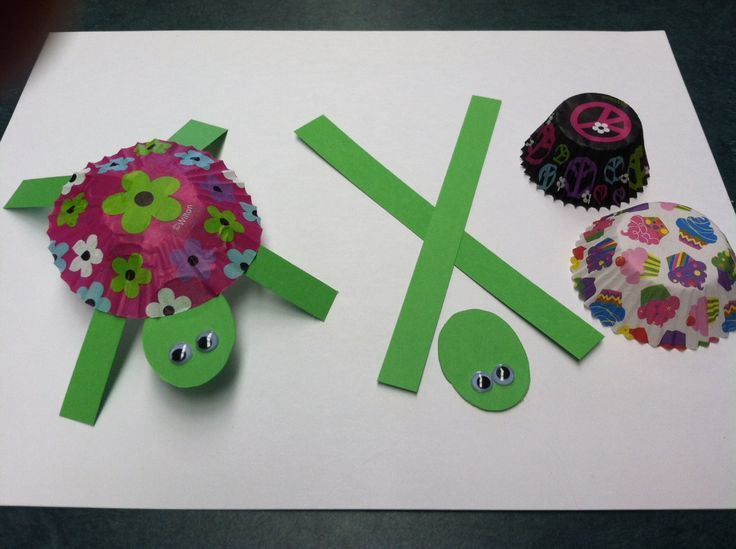 Turtle craft for kids. Super easy. Flatten cupcake liner. Glue crossed strips and head to bottom. Flip over and add eyes.