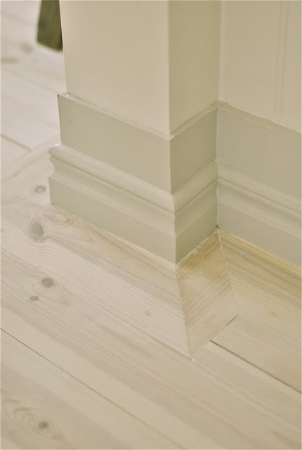 Whitewashed pine floor and beautiful grey molding