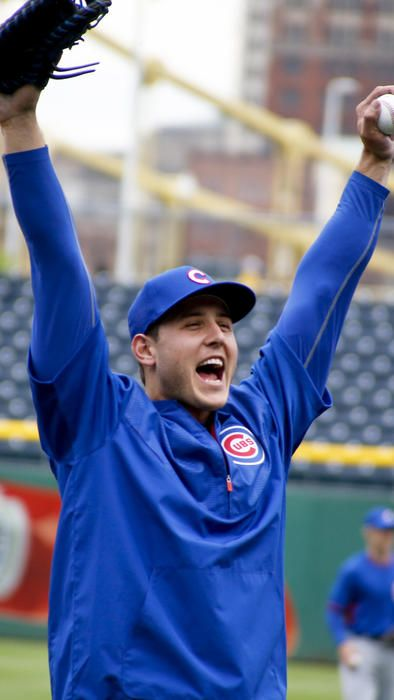 Anthony Rizzo cheers as he warms up for batting practice before a game against the Pirates on May 2, 2016. (Keith Srakocic / AP)