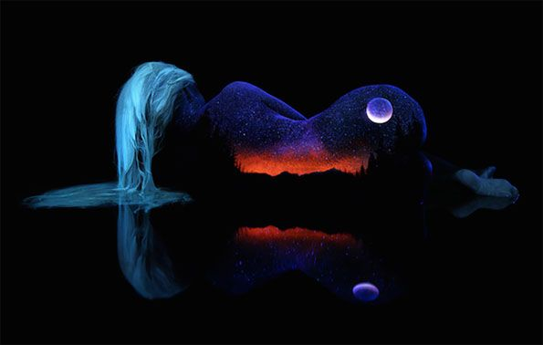 An artist uses #blacklight #paint and models to create amazing works of art!