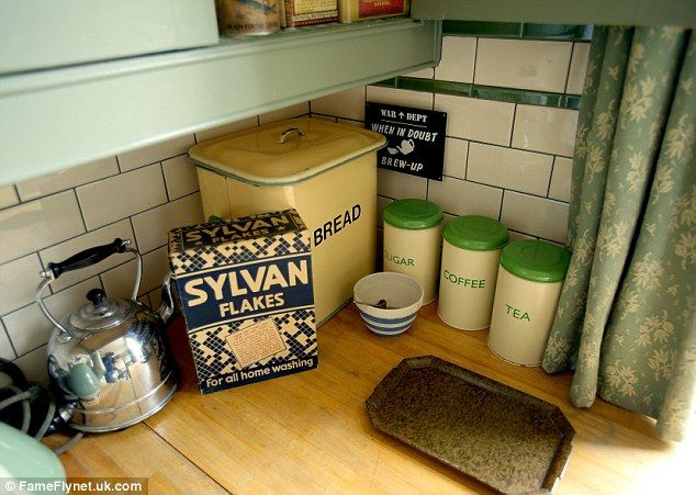 Cooking aids: Tins, a bread bin and a 1940s kettle in the kitchen...