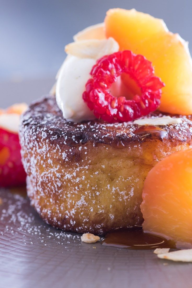 Graham Hornigold's pain perdu recipe is an elegant spin on the French toast classic, pairing perfectly poached sous vide peaches alongside a gooey peach caramel, fresh raspberries and golden pain perdu.