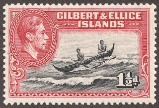 "Gilbert & Ellice Islands  1939 Scott 42 1 1/2p carmine & black  ""Canoe crossing reef"""