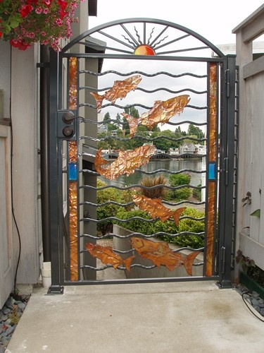 Copper salmon swim in this custom iron gate. Salmon are such a part of the Northwest ecosystem. This has been a popular design. We can make it any size or shape.
