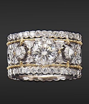 Bucceletti - I like this ring especially if you don't want both engagement ring and wedding ring.  This could do the work for both.