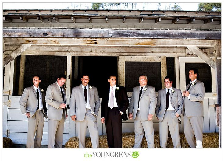 tan groomsmen suits and a black suit for the groom..i'm kinda liking this a little..interesting idea anyway