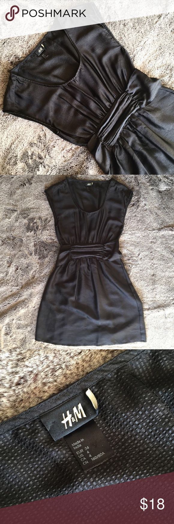 Adorable H&M black shift dress with sash Super flattering H&M dress in black with subtle stripes & shine in the material. Perfect with heels, or put on some cute leggings and a fitted jacket. Size 4, EUC H&M Dresses Mini
