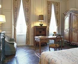 A Suite at Chateau d'Audrieu welcomes visitors to their slumber