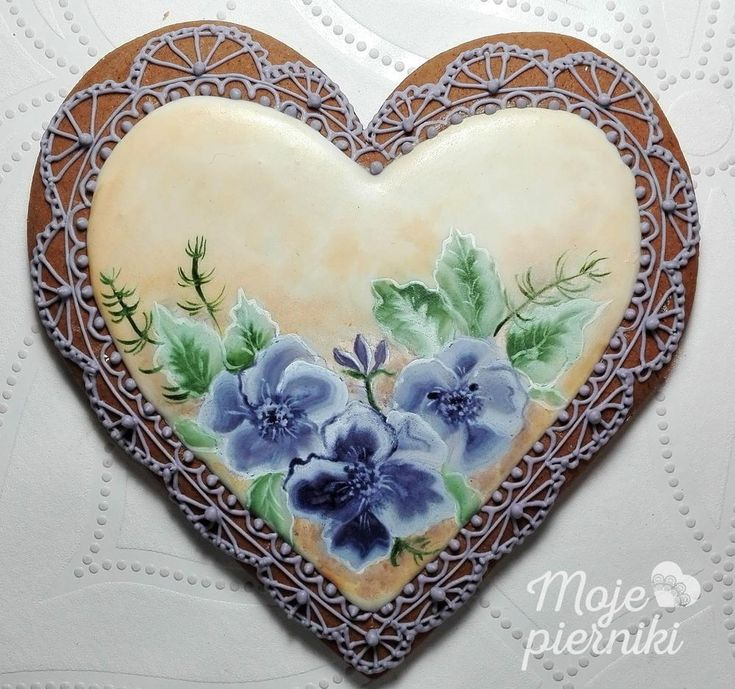 Painted pansies on gingerbread heart, royal icing crocheted lace by  E Kiszowara