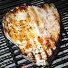 Grilled Swordfish Recipe 1/2 cup soy sauce, 1 tbls honey, minced garlic-marinade for 5 minutes each side. brush w/ butter while grilling. served w/lemon rice and veggies. 14 soles/$5.38. 2.8 soles per person/$1.08