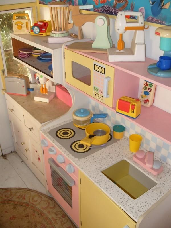 inside an outdoor play house! Ahnaleah would love this kitchen set!!!