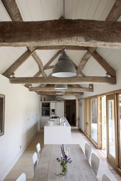 = beams, industrial pendants and white kitchen