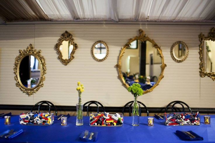 Talk about a perfect Bar Mitzvah table: Cobalt Blue Lamour with Lego centerpieces and gold ornate mirror back drop