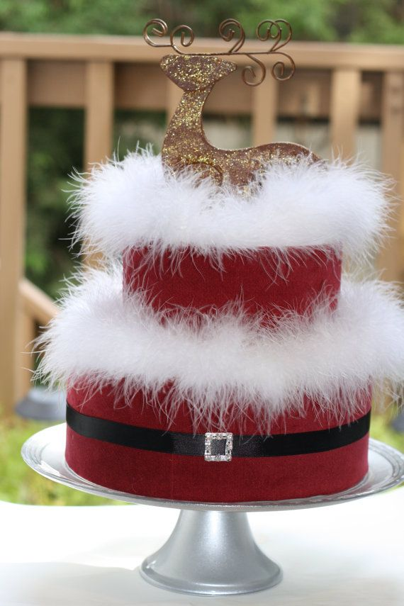 This is a Christmas diaper cake perfect for an elegant Christmas baby shower…