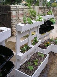 Planters out of pallets. Just build out the bottom planter so it's has a sturdy base