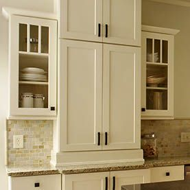 glass mullion door cabinets display dishes in shaker white cabinets