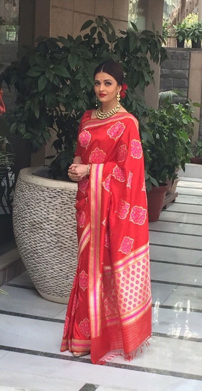 Aishwarya Rai Bachchan looking ravishing in red for lunch with French President Hollande.