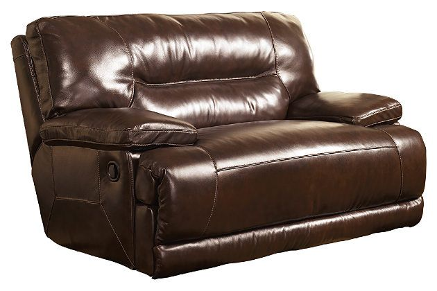 Brown leather recliner chair that folded down for your living room furniture