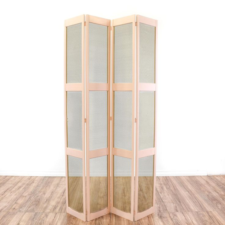 This cottage chic room divider is featured in a solid wood with a pale pink paint finish. This wall screen has 4 folding panels and wire mesh screens in a shiny brass finish. Perfect as a jewelry display with holes fit for earrings! #cottagechic #decor #wallart #sandiegovintage #vintagefurniture