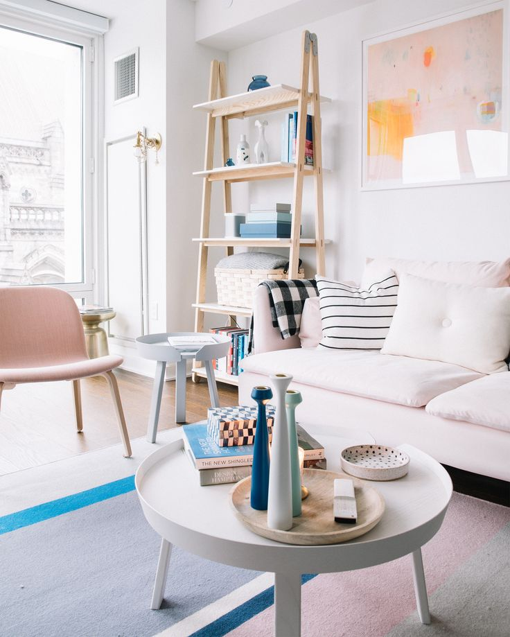 Millennial Pink Decorating Ideas From My Living Room- check out this inspiration for decor and lounge ideas using blush light pink, a light pink couch/sofa round white coffee table and scandinavian  furniture!