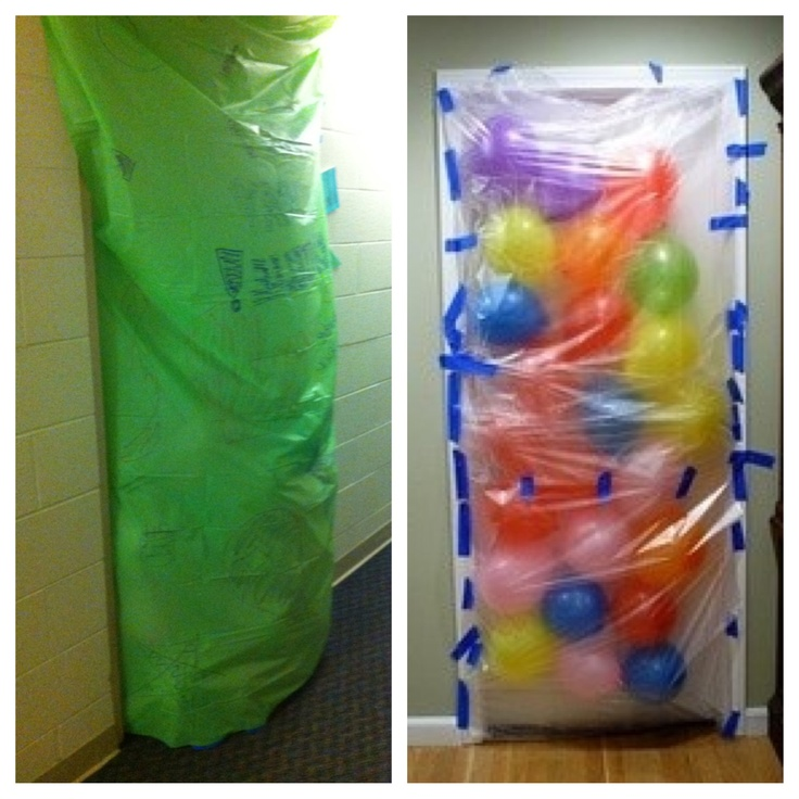 So....I did the balloon avalanche thing that keeps circulating on Pinterest...it turned out really well!! Instead of using plastic bags that are pieced together, I got a plastic table cloth that easily covered the door in a single piece!!!! I also (with help) drew messages on both the balloons and the table cloth, which made it a little more unique!!