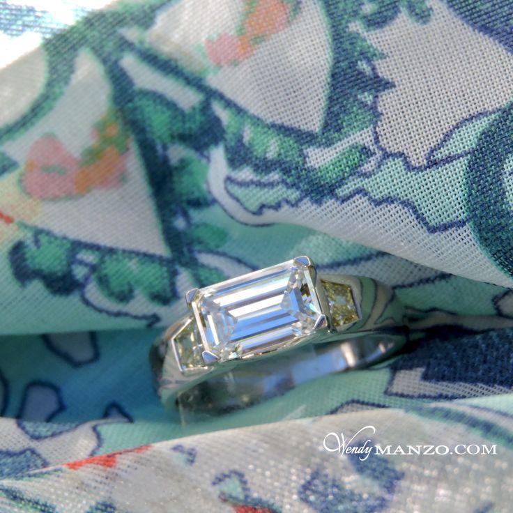Emerald cut diamond engagement ring, custom designed and hand made in platinum with Canary Yellow trapezoid cut shoulder diamonds. #wendymanzo #wendymanzodiamonds