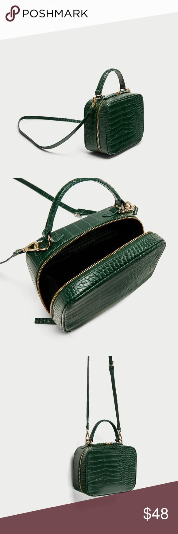 Zara EMBOSSED MESSENGER BAG Green- NWT Green crossbody bag with an embossed finish, top handle and adjustable and detachable shoulder strap. Features gold metal hardware, lined interior with pocket and top zip closure.  Height x Width x Depth: 14.5 x 19.5 x 8 cm. / 5.7 x 7.6 x 3.1″  COMPOSITION OUTER SHELL  100% polyurethane  LINING  100% polyester  FILLING  100% ethylene vinyl acetate Zara Bags Crossbody Bags