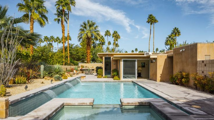 The four-bedroom home was built in 1960 and features plenty of indoor-outdoor access, views of the surrounding mountains, a fire pit, two-car garage, and a pretty luxurious-looking pool and spa.