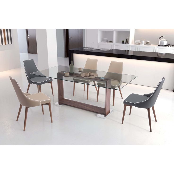 The Oasis Dining Table features a rectangular profile and measures 78.7 inches long. Base showcases a walnut finish, and glass is lightly smoked and tempered for strength.