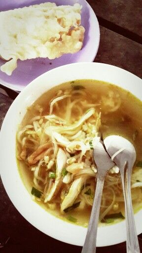 Indonesian Cuisine: Soto Ayam. (Chicken Soup with Rice, Chicken slices and veggie served with fried Tempeh)