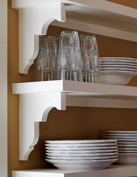 Corbels salvaged from the original house were used in the new kitchen for displaying dishes.