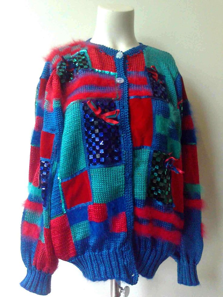 Crazy fully decorated cardigan 70%viscose 30%angora and various materials like sequins and velvetpatches €49