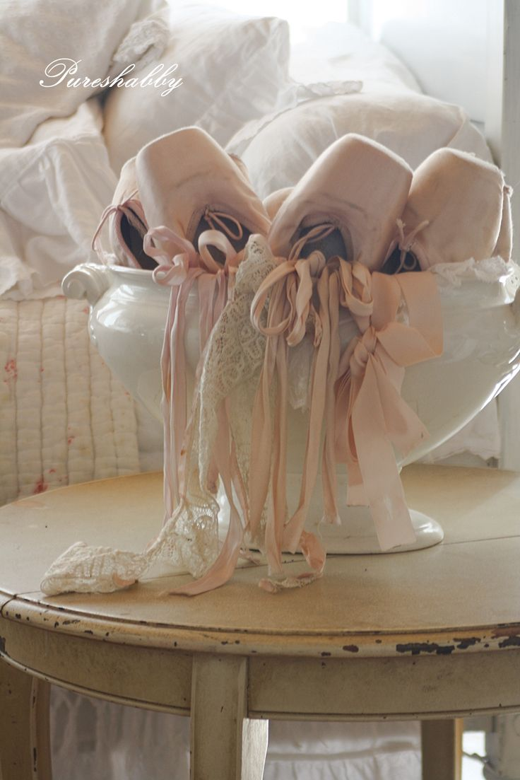 pink ballet slippers in a tureen
