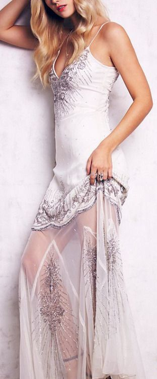 [Metallic silver embroidery. The underskirt--I'm assuming it's an underskirt--looks odd in this photo. I wish they had another picture.]