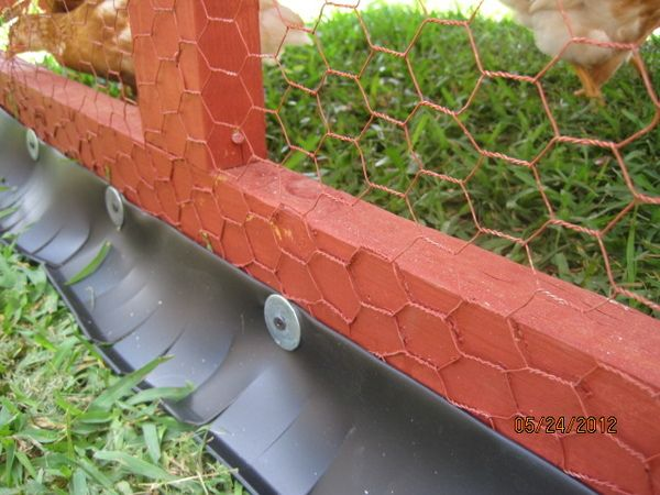 CHICKEN TRACTOR GAP /GROUND SOLUTION: Go to your local Home Depot or Lowe's and pick up three four-foot lengths of the cheapest rubber cove molding (approx. $1.55 per 4ft. sectio...