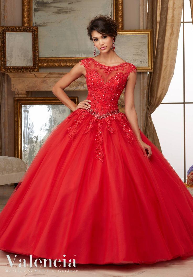Red Quinceanera Dress by Valencia Morilee designed by Madeline Gardner. Matching Stole. Princess Ball Gown with Illusion Neckline, Cap Sleeves, and Keyhole Back. Colors Available: Scarlet, Aqua, Blush, White. Crystal beading on tulle. Style 60006.