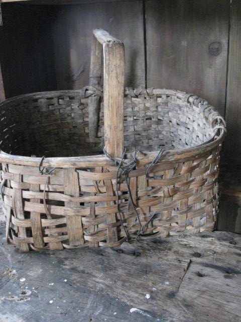 I collect old baskets.  HighButtonShoe farmhouse
