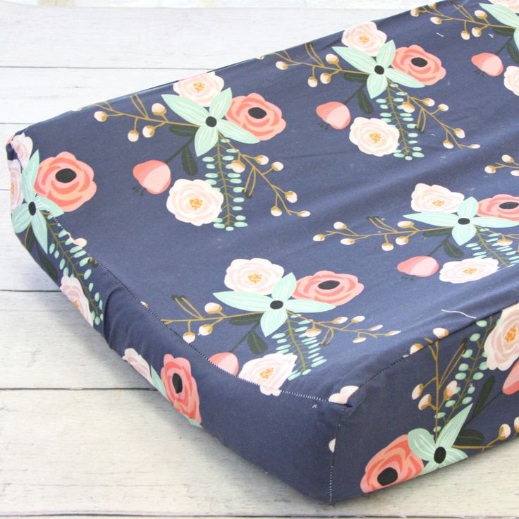 Berkeley's Floral Girl Changing Pad Cover | Pastel, Floral, Coral, Peach, Navy, Mint Baby Girl Changing Table Cover | Floral Baby Nursery by CadenLaneBabyBedding on Etsy https://www.etsy.com/listing/481416023/berkeleys-floral-girl-changing-pad-cover