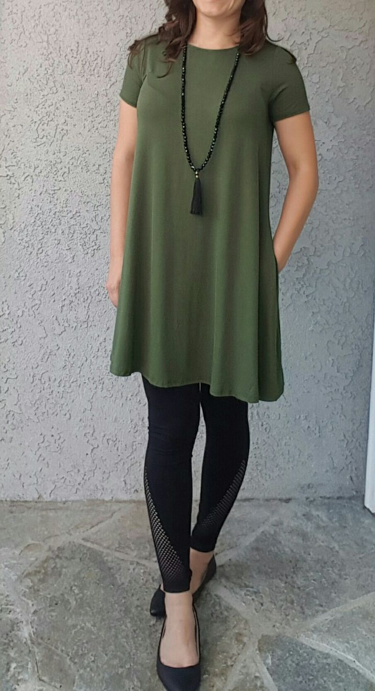 How to Style Leggings with Dresses. Keep these pointers in mind when wearing legging under a dress: Be heedful of the length of the dress so that your leggings are visible. Try faux leather leggings for a more dressy look. The long shirt/sweater/tunic will go easily with any pair of leggings.