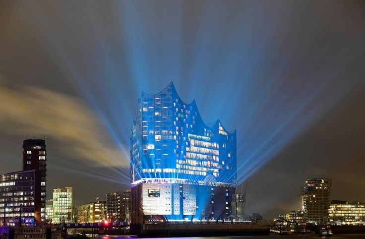 The new glass building with its bold curves roofscape rises on the base of a former quayside warehouse on the western tip of HafenCity.  Dare To Dream ~  NWest ~ QualQuest************