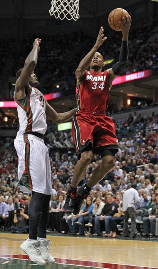 The Heat's Ray Allen in the paint as the Bucks Samuel Dalembert defends in the second quarter. The Miami Heat vs Milwaukee Bucks in Game 3 of their first-round series in Milwaukee at the BMO Harris Bradley Center on Thursday, April 25, 2013.