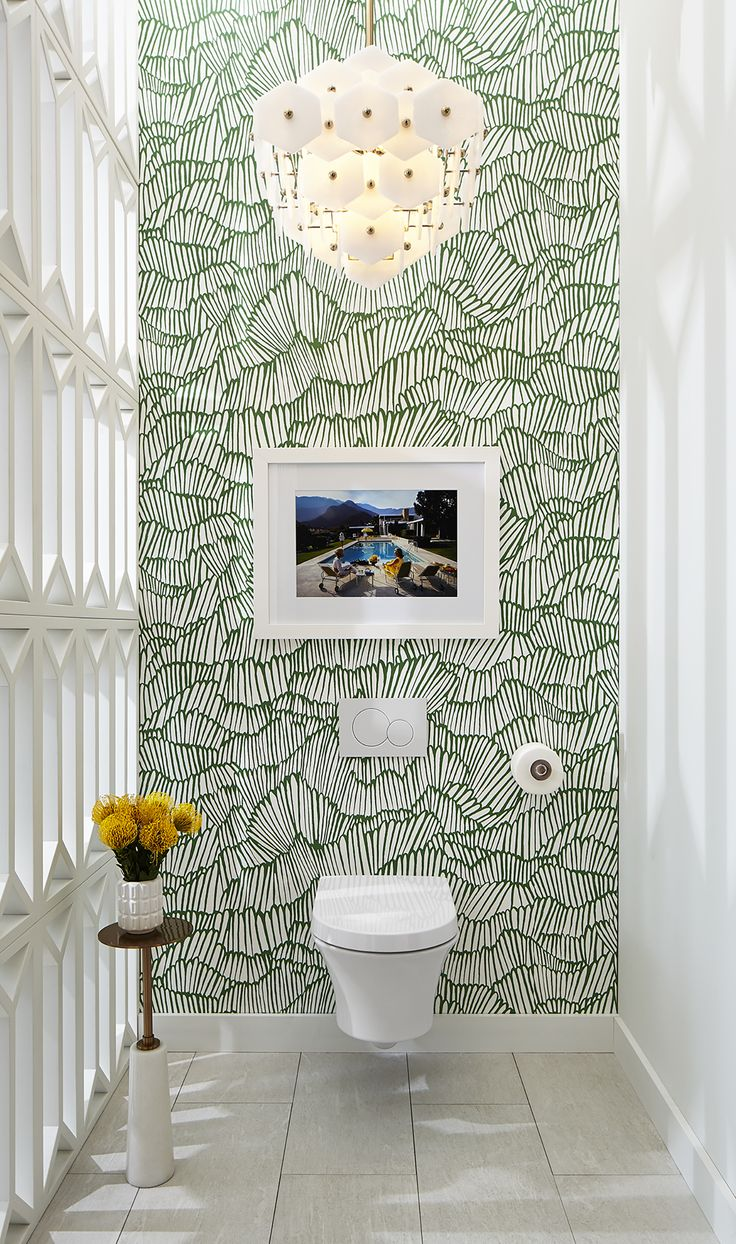 In their #DXVDesignPanel vignette, Pulp Design Studios opted to use the Seagram Wall-Hung Toilet as a gallery piece, creating a segregated space using partitions reminiscent of Palm Springs concrete blocks. Chandelier by @lampsplus