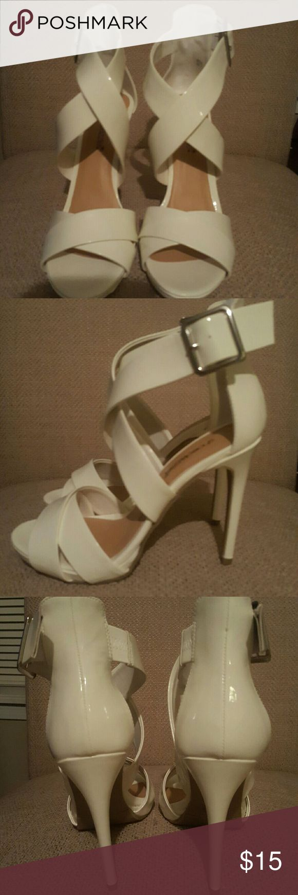 White patent leather strappy sandals size 7 Brand new shoe dazzle white strappy  sandals size 7 with a 4.5 inch heel and half inch platform. Shoes Sandals