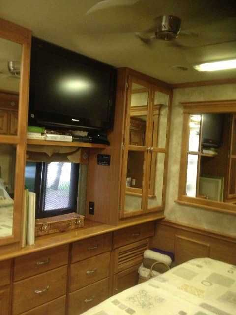 "2009 Used Tiffin Motorhomes Allegro Bay Class A in Florida FL.Recreational Vehicle, rv, GREAT PRICE!! Now $74,900 for our 2009 Tiffin Motorhome Allegro Bay , LOCATED IN VENICE, FLORIDA; SELLING DUE TO BUYING HOME IN FL. EXCELLENT CONDITION: ONE OWNER, NO PETS, NO SMOKERS. 3 slides--opposing slides in main cabin & 1 in bedroom; 26"" outside TV; full body paint; dual pane windows, 2 roof A/C with heat pumps; driver door; slide-out covers; 7 KW Onan generator; Heated wet (water) bay; heated…"