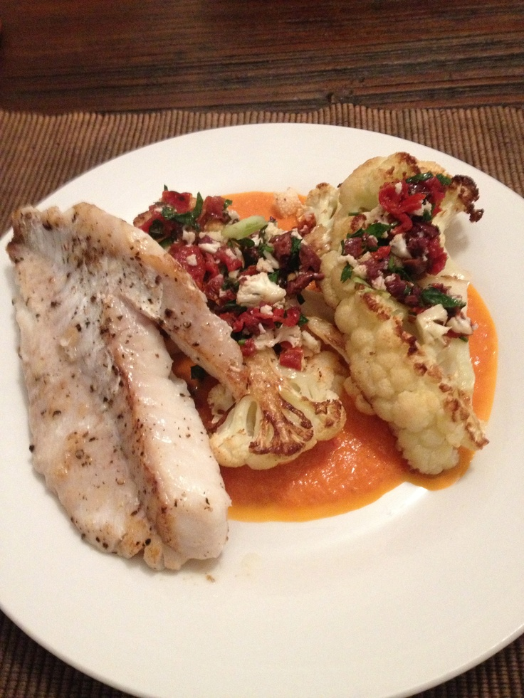 Grilled fish and cauliflower steaks with olive relish and tomato sauce