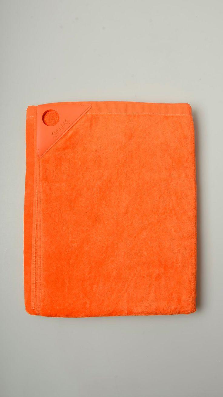 Plain orange terry cotton fabric featuring rubber label, 35'' x 57'', 100% cotton.