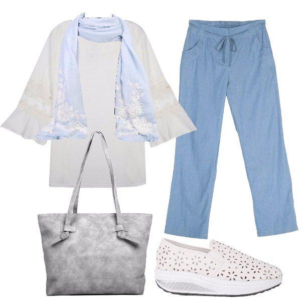 L'outfit+è+composto+da+una+blusa+bianca+con+maniche+svasate+ed+inserti+in+pizzo+da+portare+sul+pantalone+in+denim+leggero+con+coulisse+in+vita.+Il+look+si+completa+con+gli+accessori:+una+sciarpa+celeste+leggera,+la+shopping+bag+con+tasca+posteriore+e+le+slip+on+traforate+con+suola+arrotondata.