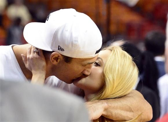 Hayden Panettiere and Wladimir Klitschko kiss during a Miami Heat game in Miami on March 24, 2013.