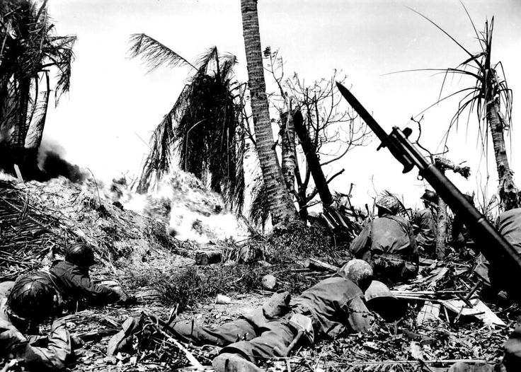 Soldiers of the 7 th Infantry Division of United States used a backpack flamethrower for the smoking of Japanese soldiers from the bunker during the invasion of the island of Kwajalein.